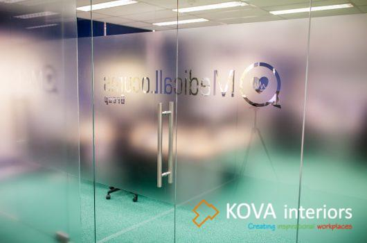 kova frameless glass door